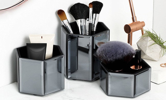 "The set includes three mirror pots.Promising Review:  ""This is a nice set for styling your dresser and to organizing your makeup brushes. The pots are very trendy and made of quality material."" —JimGet the set of three from Wayfair for $34.99.And check out our list of inexpensive products you need for your vanity here."