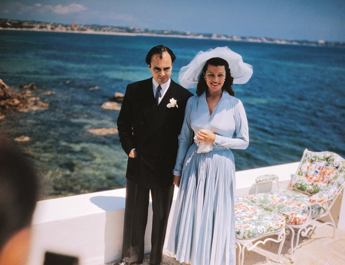 Prince Aly Khan and Rita Hayworth pose for portraits at their wedding reception held at the Château de l'Horizon in Cannes, France, on May 28, 1949.