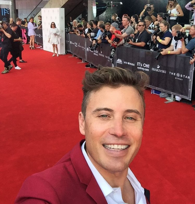 James Tobin snapped a selfie with the red carpet which was the same colour as his suit: