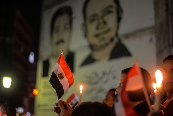 Egyptians hold candles at a vigil in Cairo's downtown district.