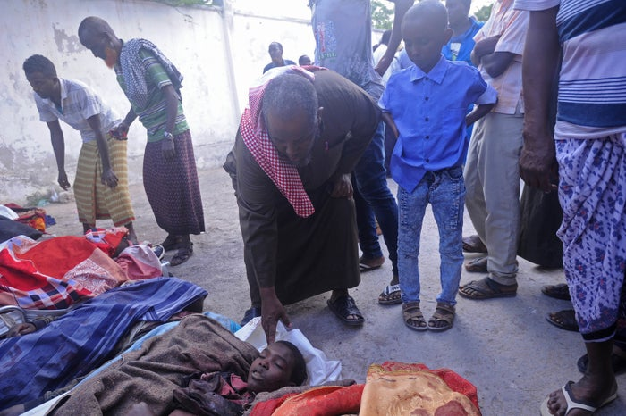 Relatives near the wrapped bodies of people killed in an August attack by Somali forces, supported by U.S. troops.