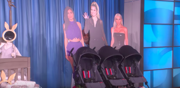 Ellen then surprised her with a whole bunch of baby gifts, including three strollers pushed by cardboard cutouts of Kylie, Khloé, and Kim.
