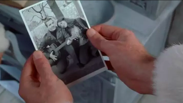 When Buddy learns he was adopted and not technically an elf, he's shown a picture of his real parents, which is when he learns his mother is already dead.