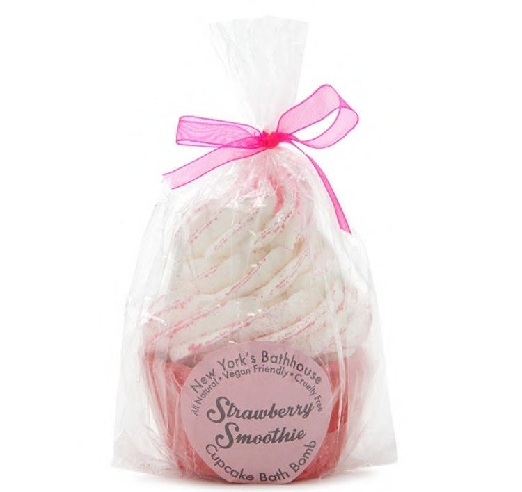 A strawberry and whipped cream cupcake bubble bath bomb for a deliciously fragrant and foamy soak.