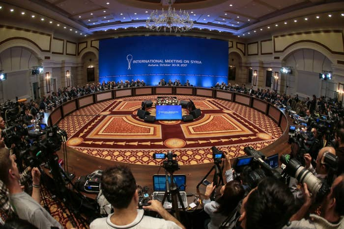 Representatives of the Syrian government and rebel groups take part in peace talks in Astana, Oct. 31, 2017.