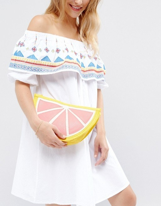A grapefruit straw clutch for adding a ~slice~ of summer to any outfit. Take it with you when you escape to the tropics this winter!