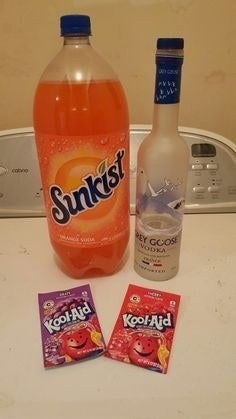 We called it a SweetTart. Get a two-liter of orange soda and pour about 1/4 of it out. Fill with vodka and two packets of Kool-Aid, usually grape and cherry, and gently mix. It tastes just like the candy! —lyndsayl4d54fd685