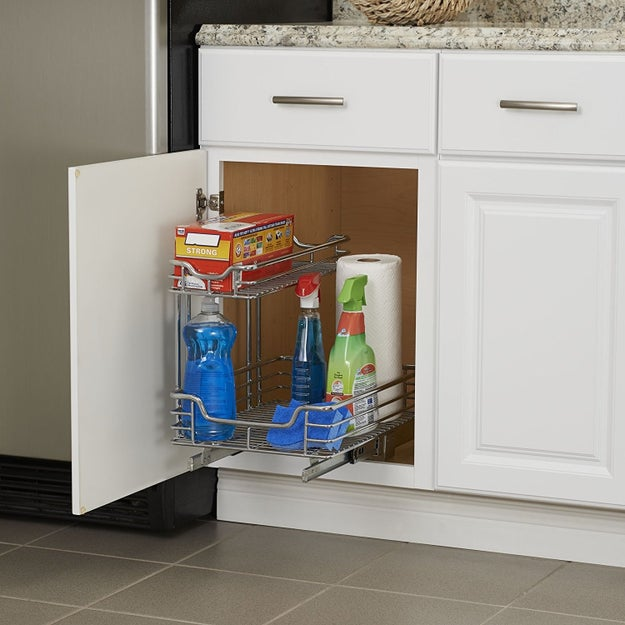 A sliding cabinet organizer that'll make reaching the stuff in the back of your cabinet considerably less burdensome —  without having to pay for custom slide-out drawers.