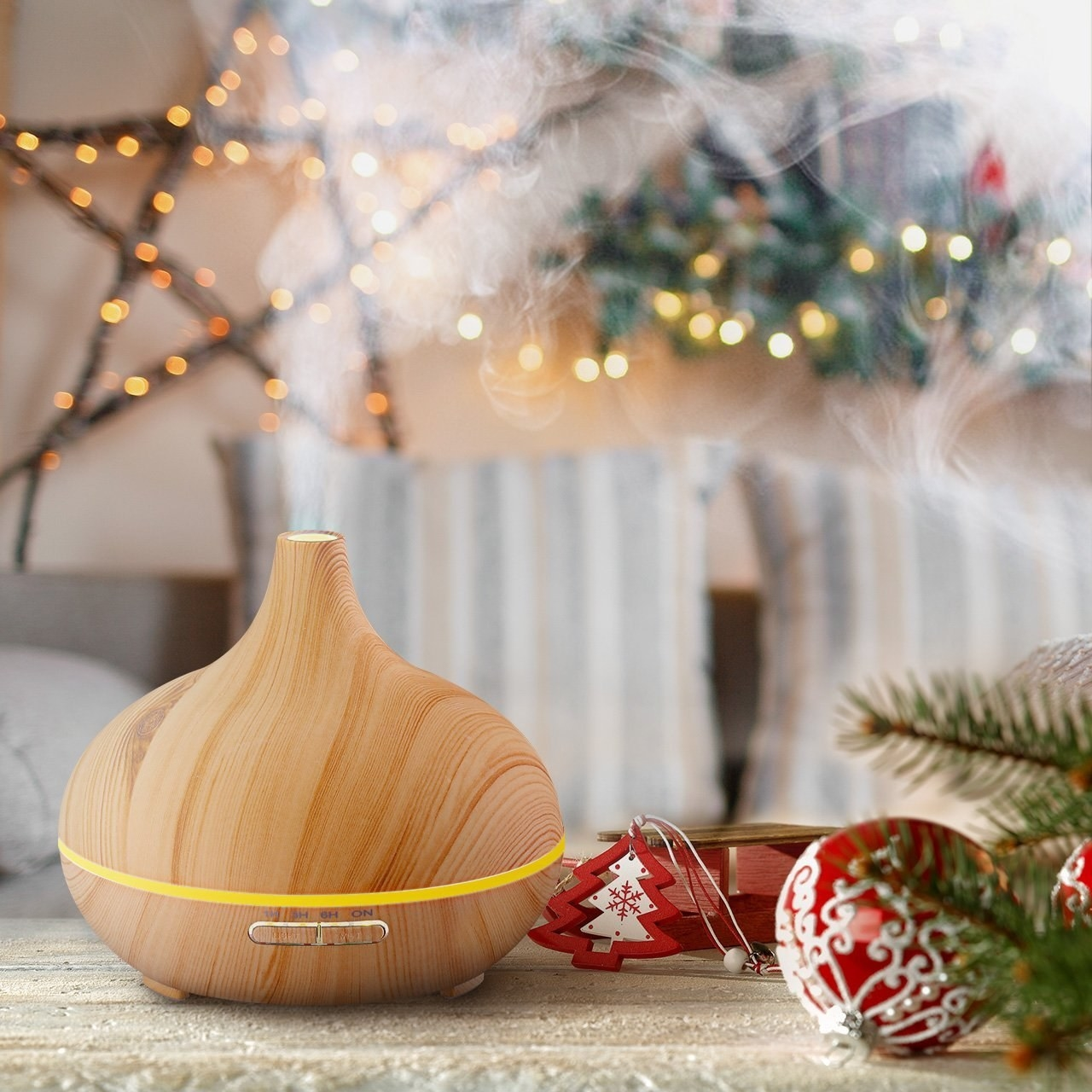 the essential oil diffuser near some holiday decorations