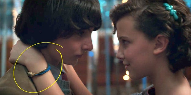 Now let's jump forward to Season 2 — Check out what Eleven is wearing on HER wrist here at the Snow Ball.