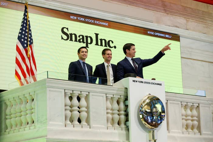 Snap cofounders Evan Spiegel (center) and Bobby Murphy ring the opening bell of the New York Stock Exchange on March 2.