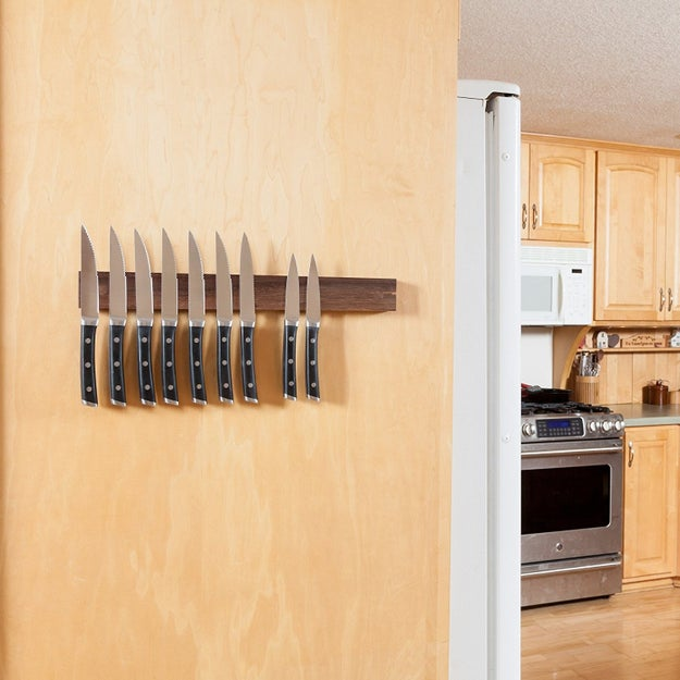 A gorgeous wooden magnetic knife rack in a ~variety~ of wood finishes to match your decor scheme.