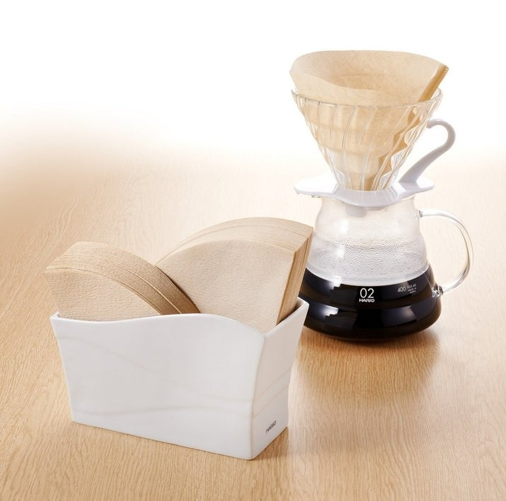 """Made specifically for Hario filters, but you can fit other pour-over filters in there!Promising review: """"At last, a smart filter organizer. Lovely ceramic."""" —Fahad MalaikahGet it from Amazon for $20.50."""