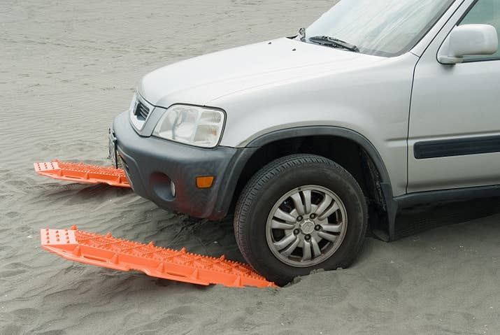 "Promising review: ""These traction pads are amazing! For anybody that's never used them, essentially you jam them against your drive tires in slick conditions or if you're stuck in sand, and your tires grip them and pull you right out! The bright orange makes them easy to see after digging them into the mud, and the knobs are durable enough to withstand a very large truck's beating. For the price, the quality, the durability, and the hundreds of uses, you can't go wrong with these. If I could give them six stars I would have!"" — SeanGet them from Amazon for $151.95 or Walmart for $167.34."