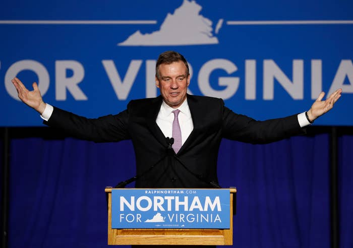 Sen. Mark Warner celebrates Democrat Ralph Northam's victory in the Virginia governor's race Tuesday night.
