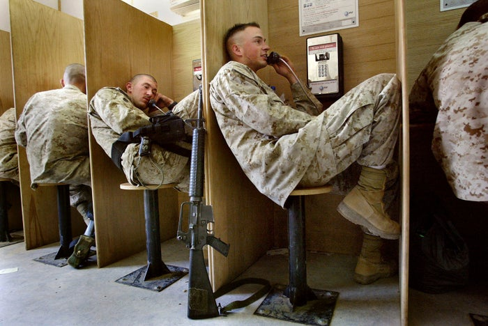 US Marines used a phone center to call friends and relatives from Iraq in 2004.