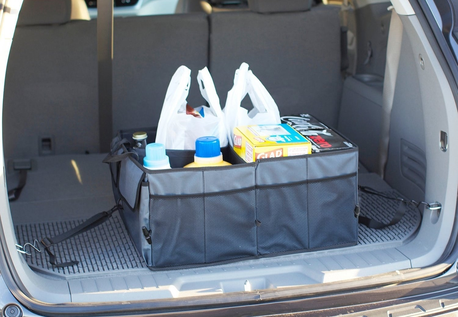 "Promising review: ""I have used this product both in the back of my car and in the passenger seat while traveling. I like the tie-down hooks that allow me to fasten the product to the back of my cross-over vehicle, it keeps items stable and protected. I'm able to place my cooler in it to stabilize my glass purchases—which helps tremendously. On my last long-distance trip, I used it in the passenger seat to stabilize my water bottles, my books, my snacks, and everything was at arms-reach. Best of all, I wasn't hunting for stuff in the floorboard because I hit the brakes."" — RedsDaughterGet it from Amazon for $23.61."