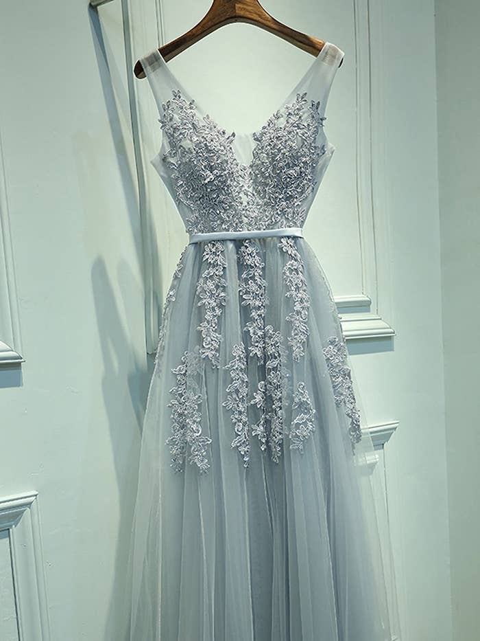 48e95b23398 A silver V-neck tulle dress covered in floral applique to make you feel  like the belle of the ball (I mean