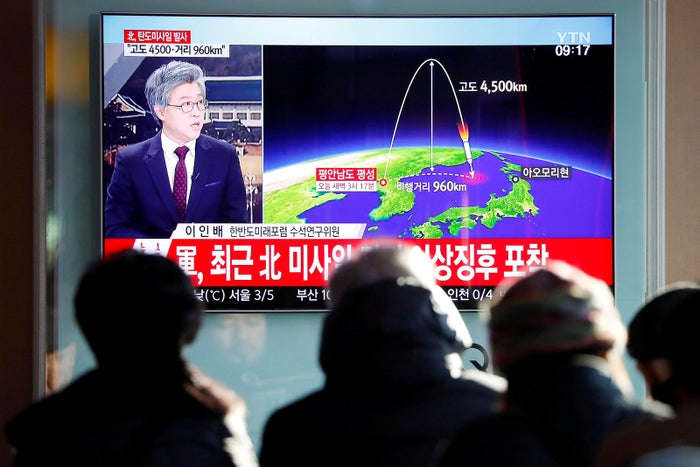 People in Seoul watch a television broadcast of a news report on North Korea firing what appeared to be an intercontinental ballistic missile that landed close to Japan on Nov. 29.