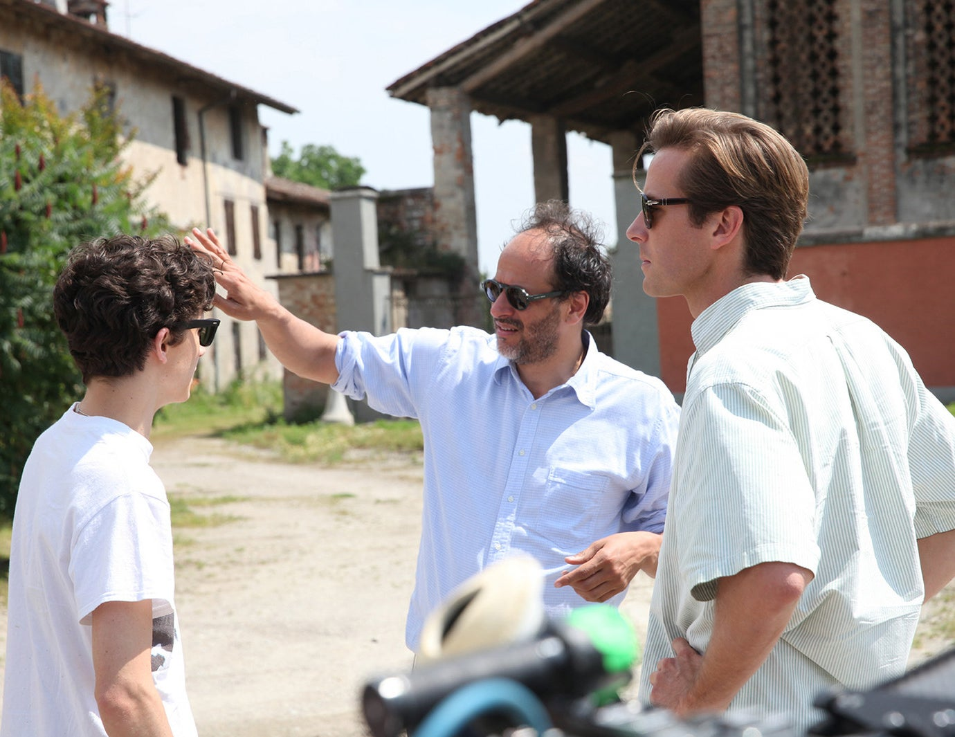 Director Luca Guadagnino on the set of Call Me by Your Name with Timothée Chalamet and Armie Hammer.