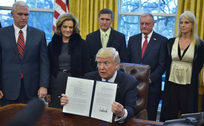 Michael Flynn, center, stood behind the president as he displayed an executive memorandum on defeating ISIS in January. Also shown are Vice President Mike Pence, then-deputy national security adviser K.T. McFarland, retired Lt. Gen. Keith Kellogg, who is chief of staff of the National Security Council, and presidential counselor Kellyanne Conway.