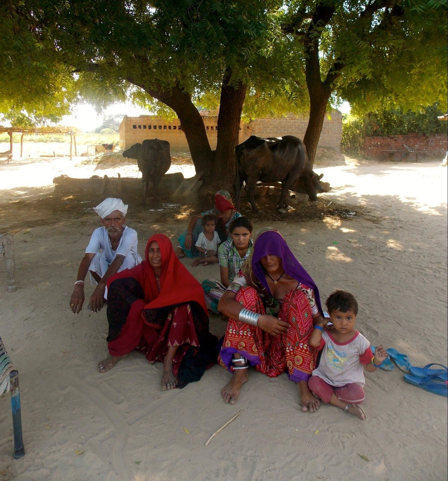 Rurhiben Patel (left) with her family. Her home, once built on fertile soil, now stands on sand.