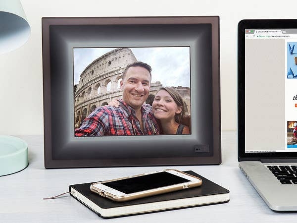 An Electronic Picture Frame You Can Sync With Your Phone So Precious Memories Will Play On A Loop Now Dads Everywhere Stop Asking Us To Print Out Every