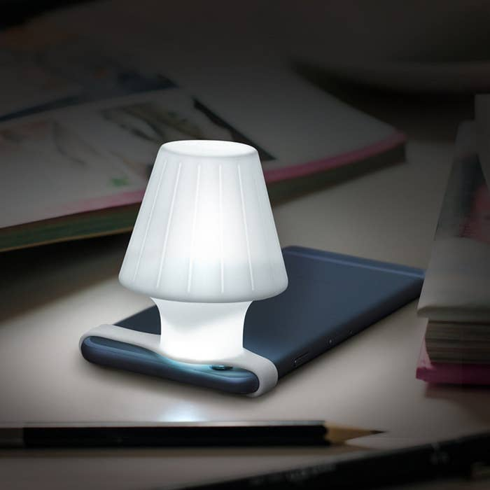 "Promising review: ""I got this for my husband because we camp a lot and I thought it would be funny to turn our phone lights into a lantern. Honestly, it's a really handy little thing. I use it a lot!"" —ImaturtleLTGet it from Amazon for $16.95+ (available in two styles)."
