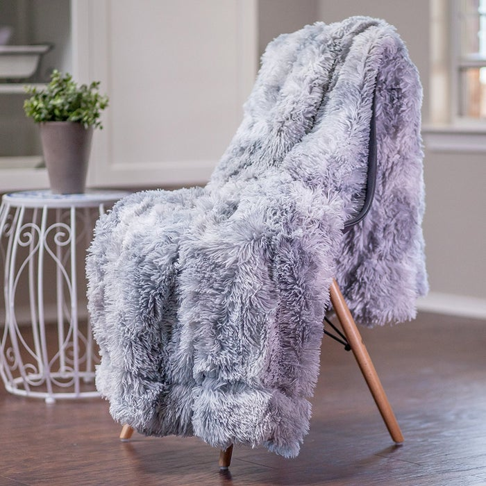 """They'll take it from the bed to the couch to the dinner table and then back to bed again.Get it from Amazon for $27.99.Promising review: """"I am sooooooooooooo happy with this fluffy, furry, very soft throw! The color is exactly how it was shown. I'm also glad to hear that it is machine washable! I would DEFINITELY purchase this again!"""" —Connie"""