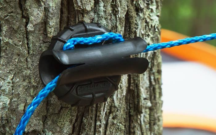 1 A Speed Cinch Anchor Thatll Make Anchoring Lines For All Kinds Of Outdoor Activities So Much Easier Like Tarps Trail Cameras Clotheslines And More