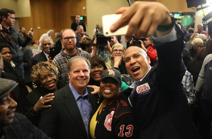 Doug Jones takes a selfie with Sen. Cory Booker, Rep. Terri Sewell, and supporters at Alabama State University on Dec. 9, 2017, in Montgomery, Alabama.