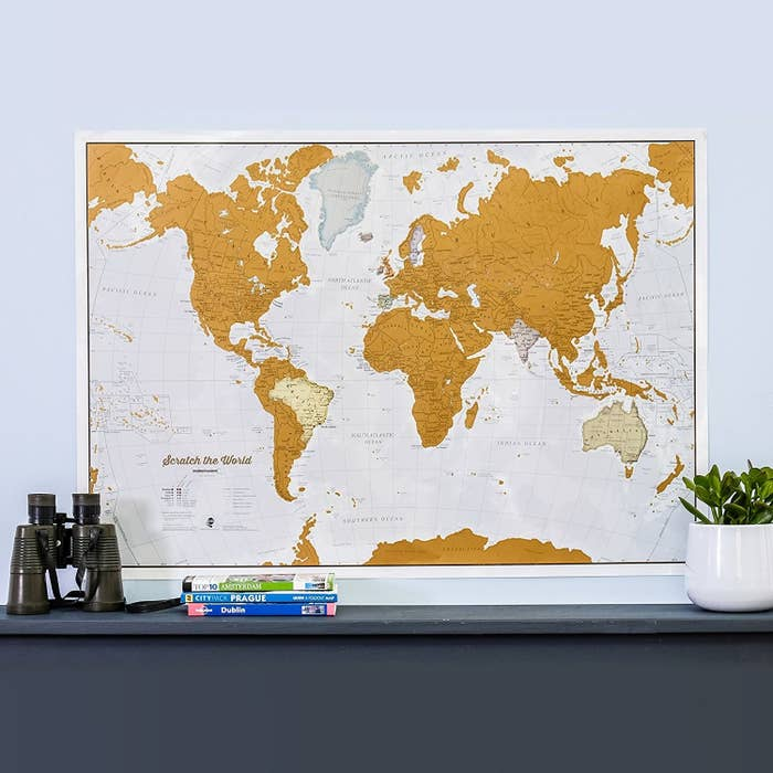 """The map is 33¼ x 23½ inches, and they can scratch off the countries they've visited (because as everyone knows, bragging is an integral part of travel). Promising review: """"Great gift for a traveler! I bought this for a relative who travels frequently. She loved it. It would be great framed. The countries are marked for easy scratching."""" —knightriderGet it from Amazon for $29.99."""
