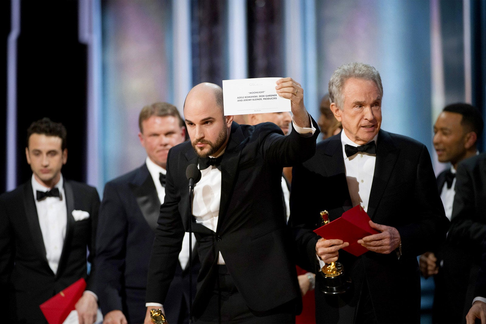 After accidentally being announced as the winner for Best Picture, La La Land producer Jordan Horowitz holds up the actual winning card for Moonlight, alongside actor Warren Beatty and host Jimmy Kimmel at the 89th Annual Academy Awards on Feb. 26, in Hollywood.