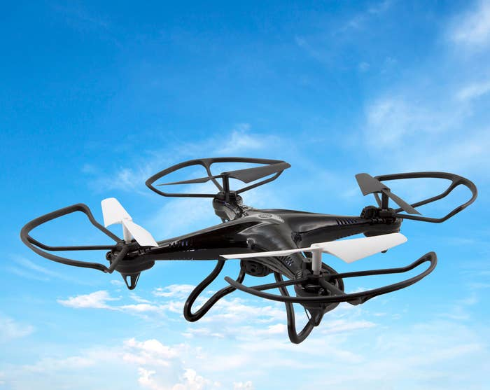 """Includes 0.3 MP video recording, Micro SD card slot, 2.4GHz remote control, a 6-axis gyroscope, and runs on AA batteries (not included). Promising Review: """"This drone is great fun and great for children. It is easy to put together and I enjoyed it with my son. He was able to learn how to control it really fast and he's only eight-years-old. His dad had fun with it too!"""" —RosePrice: $29.97"""