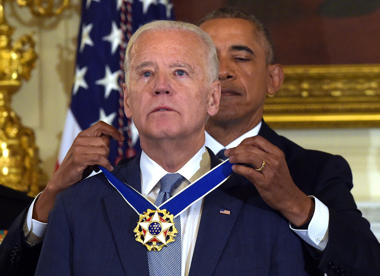 President Barack Obama presents Vice President Joe Biden with the Presidential Medal of Freedom during a ceremony in the State Dining Room of the White House on Jan. 12.