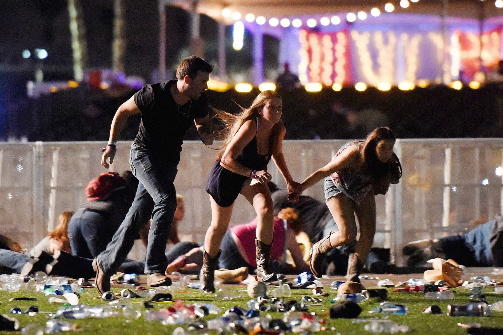 People run from the Route 91 Harvest country music festival after a gunman opened fire on Oct. 1, in Las Vegas, leaving 59 people dead and injuring 546.