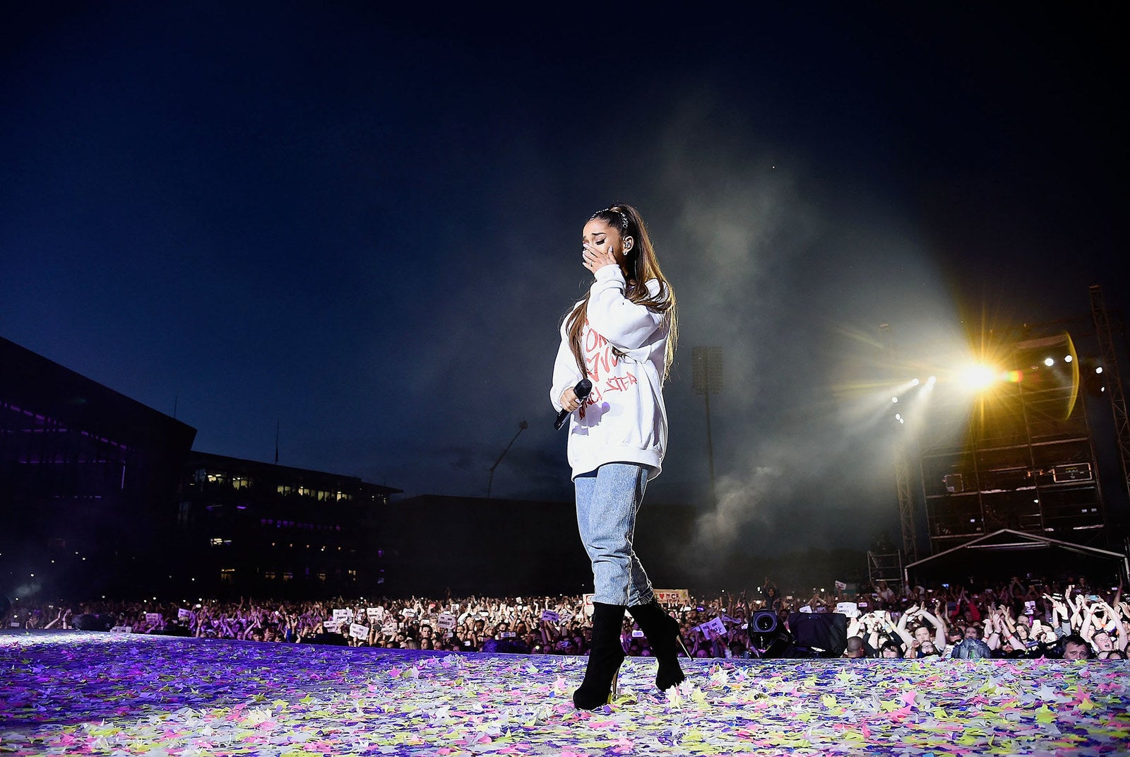 Ariana Grande wipes away a tear as she performs on stage during the One Love Manchester Benefit Concert at Old Trafford on June 4, in Manchester, England, following a terrorist attack at her Manchester Arena performance that left 23 dead and injured 512.