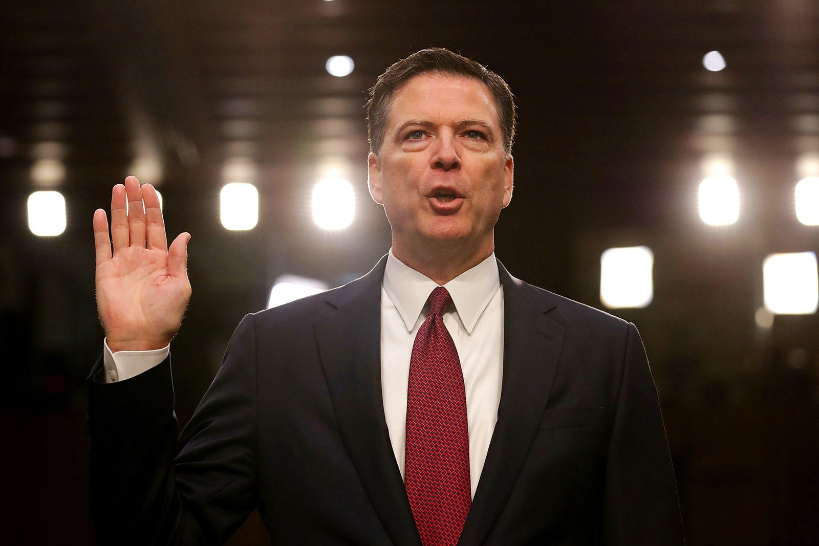 Former FBI director James Comey is sworn in on June 8 while testifying before the Senate Intelligence Committee in the Hart Senate Office Building on Capitol Hill. Comey said that President Donald Trump pressured him to drop the FBI's investigation into former national security adviser Michael Flynn and demanded Comey's loyalty during the one-on-one meetings he had with the president.