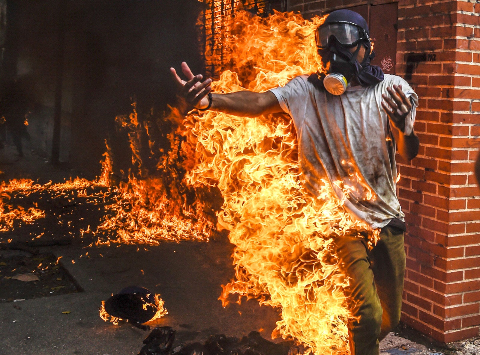 A demonstrator catches fire after the gas tank of a police motorbike exploded during clashes in a protest against Venezuelan President Nicolas Maduro in Caracas on May 3.