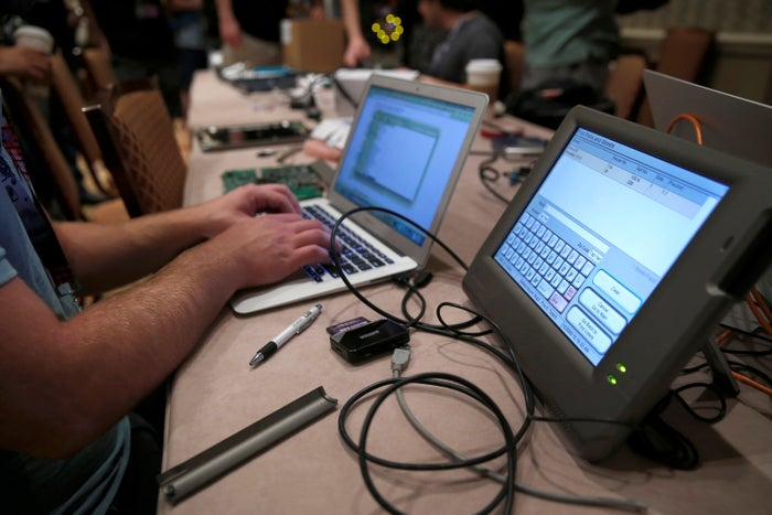 A hacker tries to alter data from an electronic poll book during the Def Con hacker convention in Las Vegas, Nevada, in July.