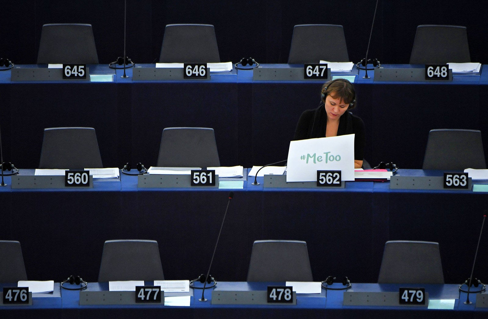 """Swedish MEP Linnéa Engström sits behind a placard placed on her desk that reads """"Me too"""" during a debate about combating sexual harassment and abuse in the EU at the European Parliament in Strasbourg, France, on Oct. 25."""