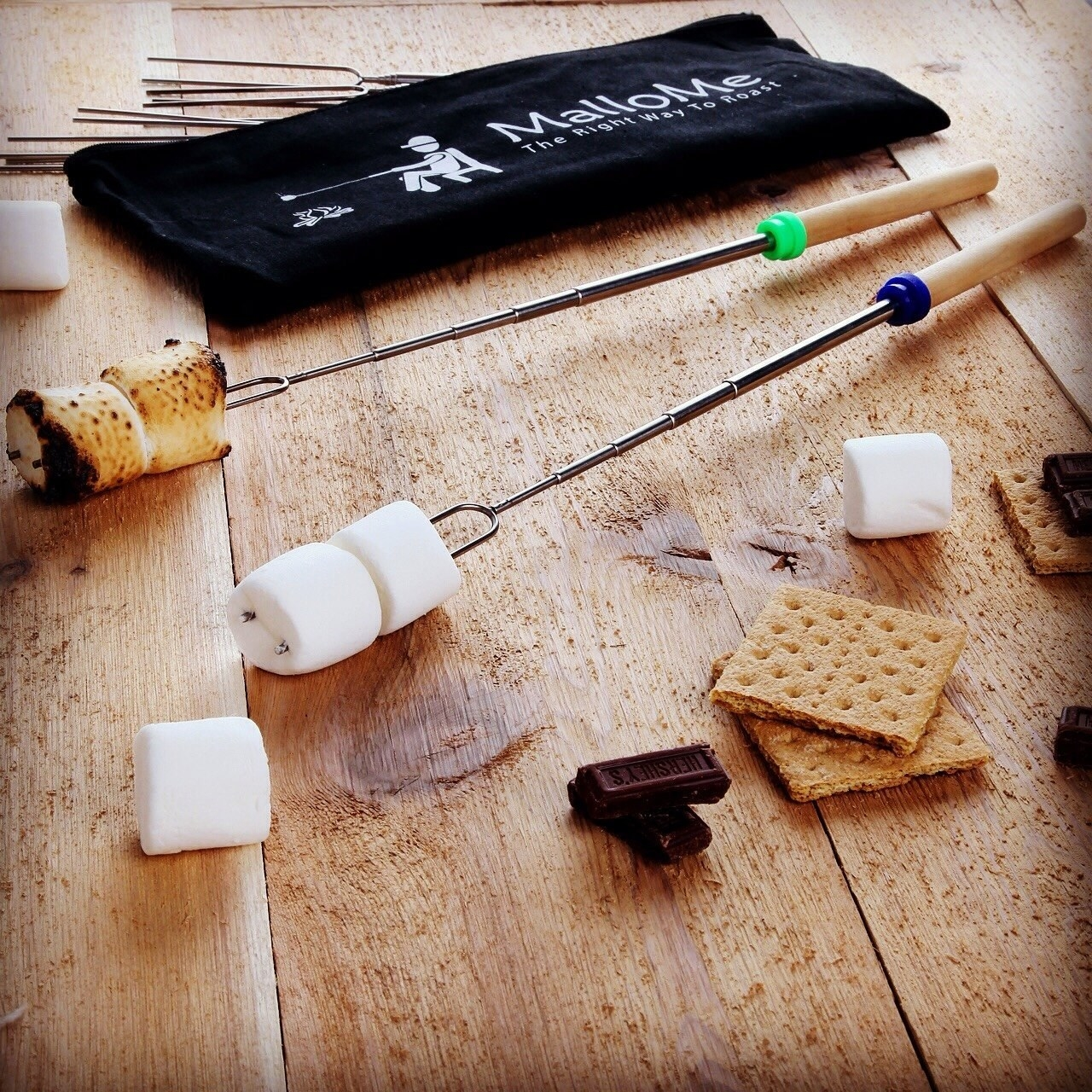 extendable sticks with marshmallows on the end
