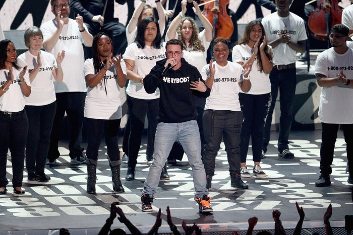 """After performing his song """"1-800-273-8255"""" (which is the number of the National Suicide Prevention Hotline), and surrounded by people who had survived suicide attempts, Logic began, """"I just want to take a moment to thank you for giving me a platform to talk about something that mainstream media doesn't want to talk about: mental health, anxiety, suicide, depression, and so much more that I talk about on this album.""""He went on to give a speech that touched on suicide, racism, sexism, anti-gay sentiment, and other pressing issues."""