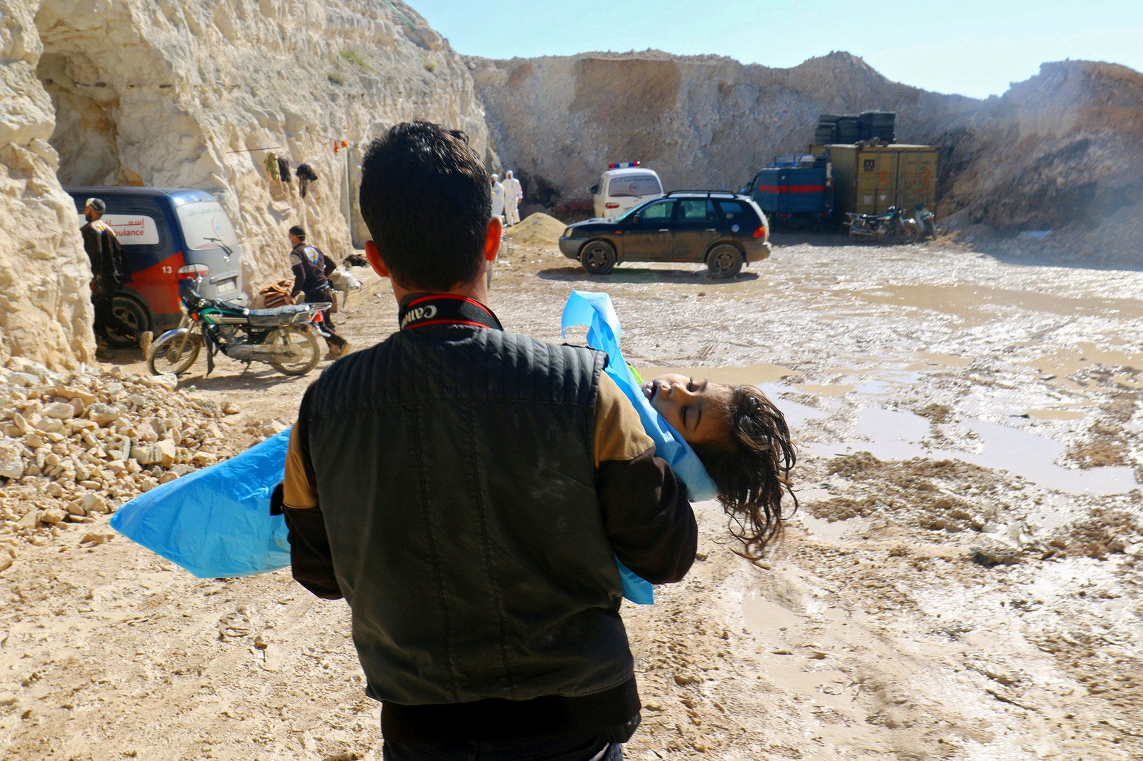 A man carries the body of a dead child after what rescue workers described as a suspected gas attack in the town of Khan Sheikhoun, Syria, on April 4.