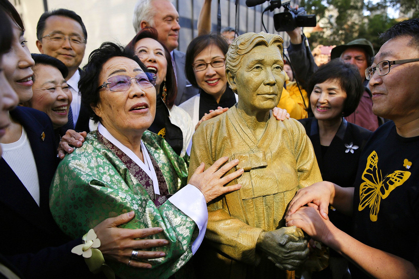 """Former World War II """"comfort woman"""" Yongsoo Lee, 89, of South Korea, stands by a statue of Haksoon Kim after it was unveiled on Sept. 22, in San Francisco. The monument was dedicated to the young women victims of Japanese military sexual slavery from 1932 until the end of World War II in 1945."""