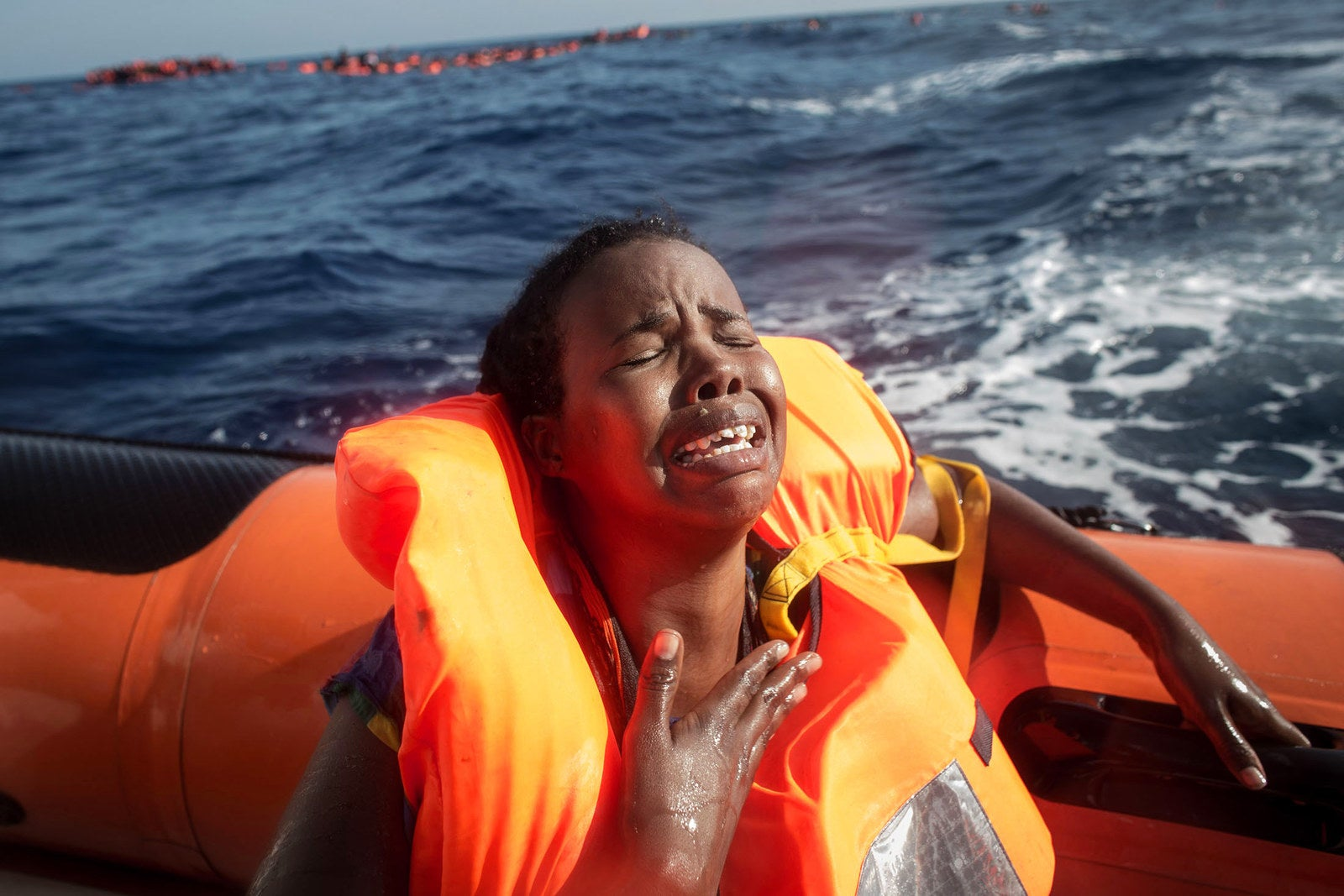 A woman cries after losing her baby in the water as she sits in a rescue boat from the Migrant Offshore Aid Station Phoenix vessel on May 24, off Lampedusa, Italy. The Phoenix vessel rescued 603 people after one of three wooden boats partially capsized leaving more than 30 people dead.