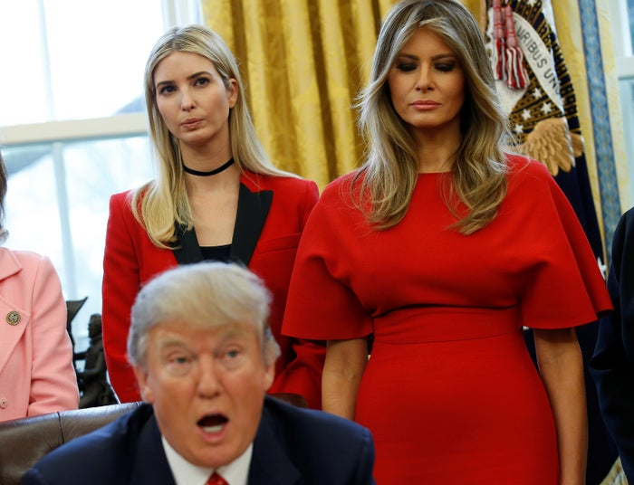 Ivanka and Melania Trump listen as President Donald Trump speaks in the Oval Office.
