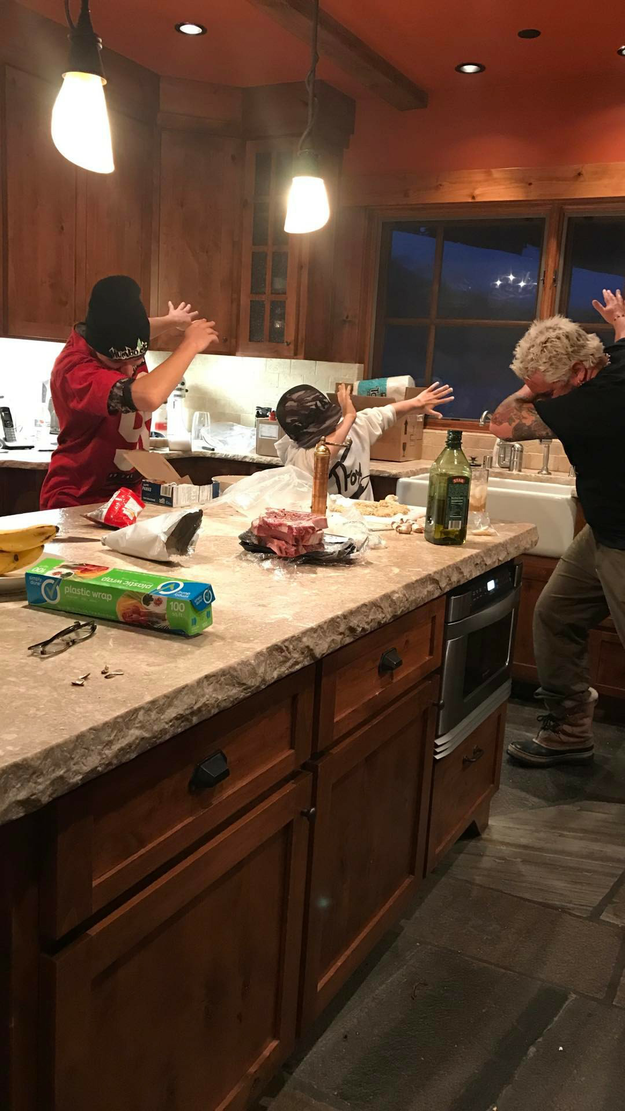 Guy Fieri dabbing with his sons.