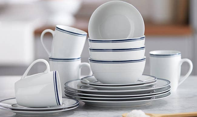 """The 16-piece set includes four dinner plates, four dessert plates, four bowls, and four tall mugs. The dishes are microwave-, oven-, and dishwasher-safe. Promising Review: """"These dishes are stylish, classic, and durable. I was looking for an everyday set of dishes, and these were the perfect fit. I have noticed no flaws, and the dishes are a good weight and easy to clean."""" —Jaunna Bekcham Get them from Amazon for $22.27+ (available in four colors)."""