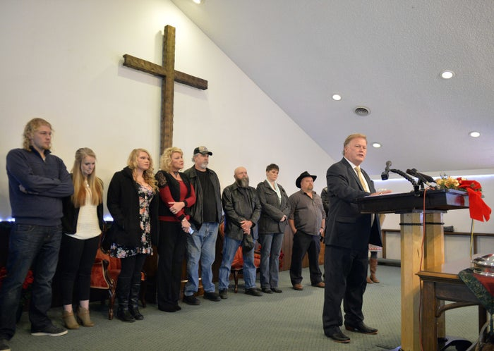 With friends and family standing behind him, Johnson addressed the public from his church.